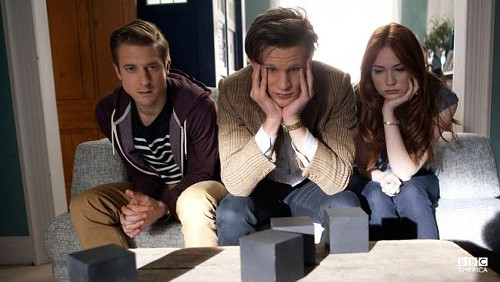 The Doctor, Amy and Rory sitting waiting for the Cubes to do something