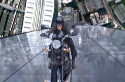 The Doctor rides an anti-grav motorbike up the Shard